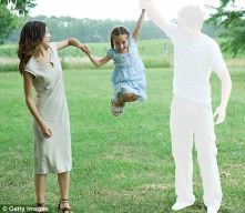 young girl swings from her parents' arms, but the father character has been painted over in white so that only the mother and daughter are visible while the father figure is vacant in the photo